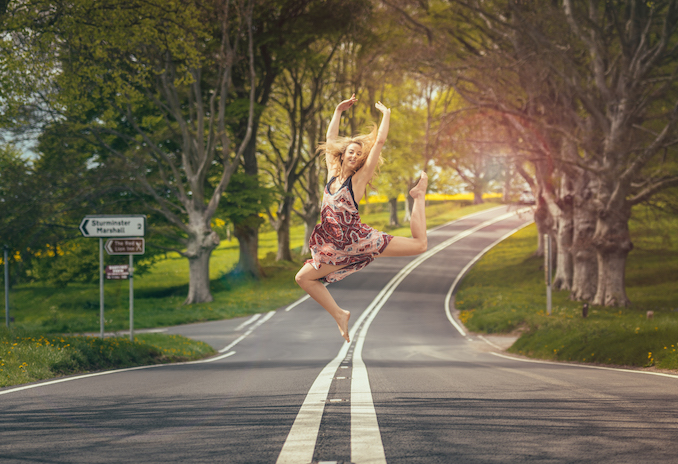 Dancing Girl Jumping In Street Looking Happy