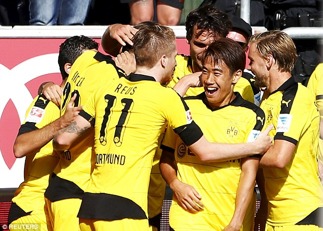 Shinji Kagawa and Marco Reus at the centre of the celebrations as Dortmund took the lead