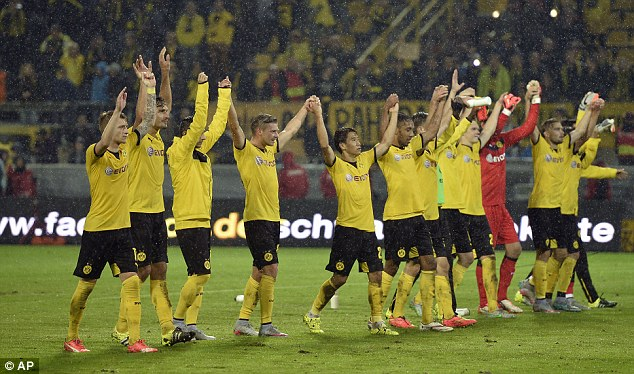 The Dortmund team celebrate againt odd