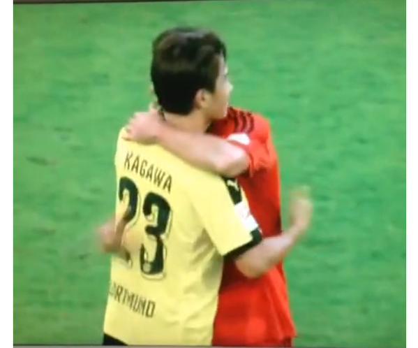 Kagawa and Chicharito hugging after this Dortmund Leverkusen