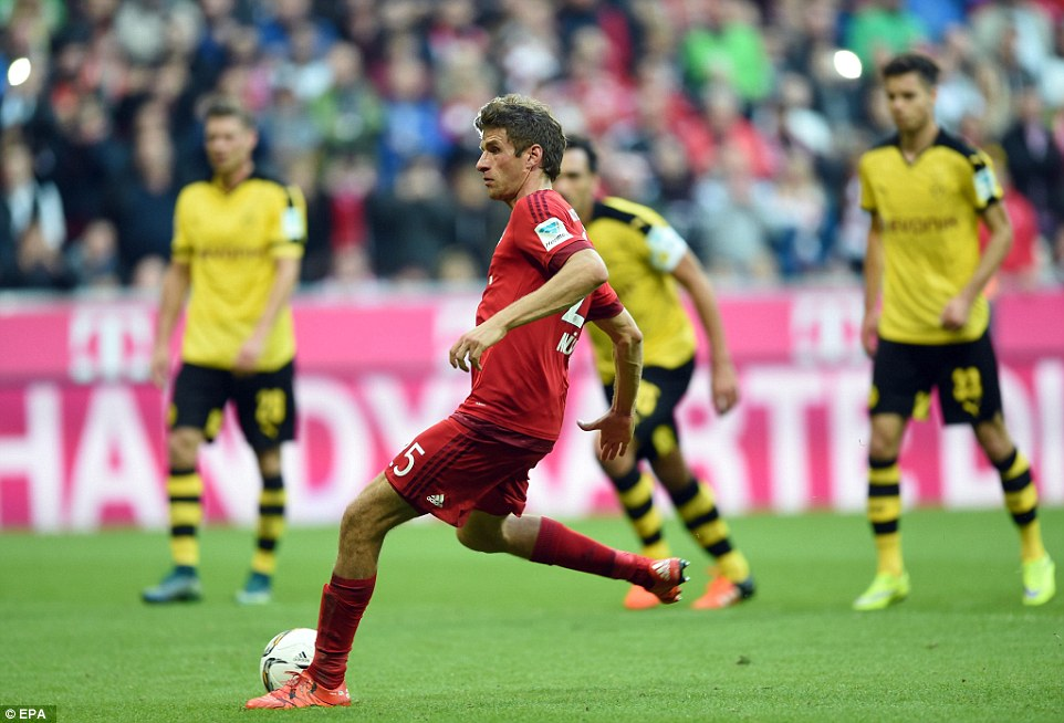 Muller nets a second for Bayern in the first-half from the penalty