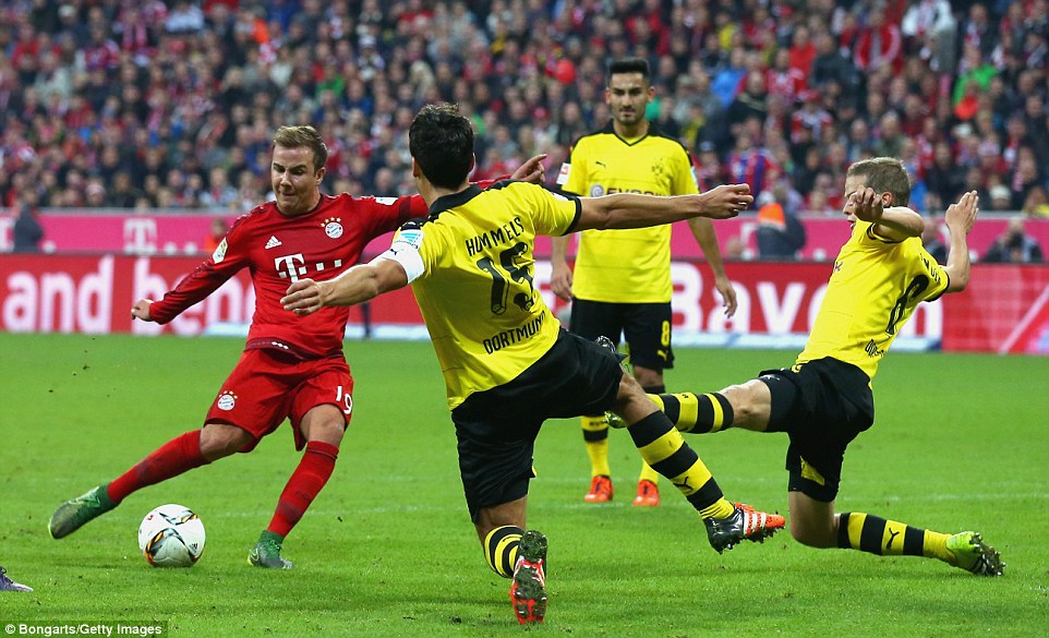 Mario Gotze adjusts his body before shooting to score