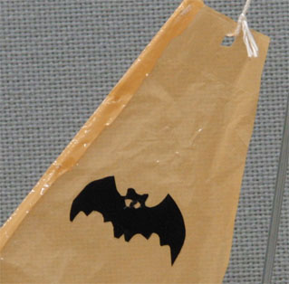 a figure of bat on a sail cut from a adhesive sheet